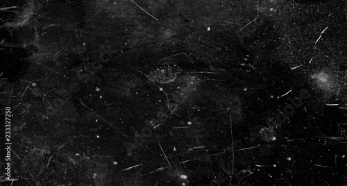 Black scratched grunge background, old film effect, space for text © Victor