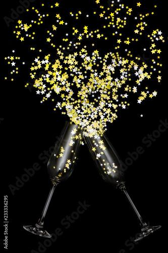 Two glasses with splash of golden stars - 233336295