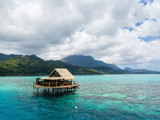 Lonely overwater bungalow of black pearl farmers. Blue azure turquoise lagoon with corals. Emerald Raiatea island, French Polynesia, Oceania. - 233347271