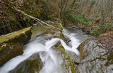 Tuscany, Italy, a waterfall of a small stream in the mountains near Arezzo on a winter day