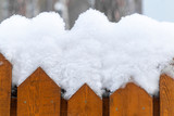 wooden fence in the snow - 233361681