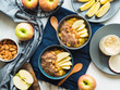Leinwandbild Motiv Cozy morning concept with turmeric amaranth porridge served with apples, flax seeds and almonds. Healthy plant based vegan breakfast. Flat lay