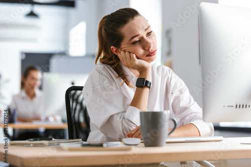 Bored young woman dressed in shirt