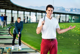 Man golf player is ready to enjoy game at golf course