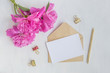 Leinwandbild Motiv Mockup white greeting card and envelope with pink peonies