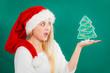 Woman holding decorative christmas tree