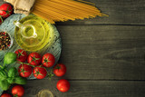 Italian pasta with tomatoes, basil and oil, top view - 233409068
