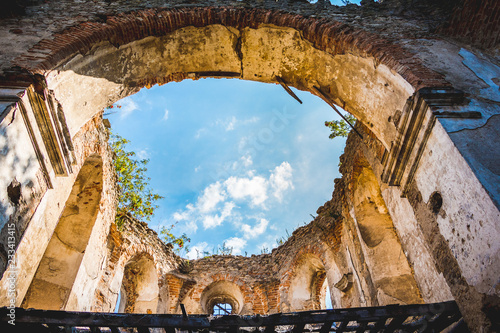 The ruins of an ancient medieval castle, the sky is visible through the ruined ceiling_