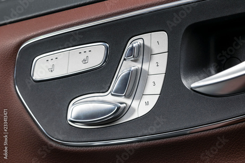 Door Handle With Power Seat Control Buttons Of A Luxury Passenger