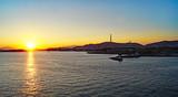 Puesta de sol en el puerto de Atenas, Grecia, Europa - 233416667