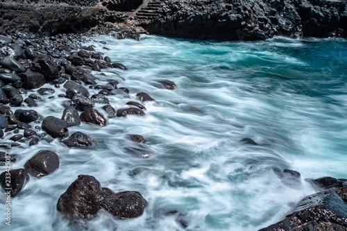 Foto Murales waves on the rocks