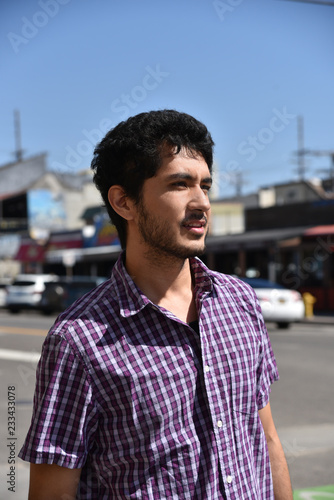 Foto Murales Handsome young man at a beach town