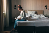 Girl reading a book in bedroom - 233436698