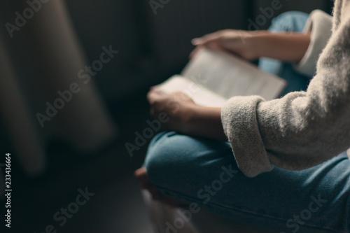 Leinwandbild Motiv Girl reading a book in bedroom