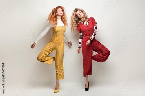 Leinwandbild Motiv Sensual Woman Having Fun in Studio. Fashion Outfit