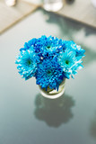 bouquet of flowers in glass vase on blue background - 233442203