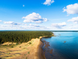 Aerial view of seashore with beach, lagoons. Coastline with sand and water. Landscape. Aerial photography. Birdseye. Sky, clouds. Stunning sky clouds. Sky landscape.