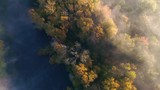 An aerial shot of a river on a foggy fall morning - 233477290