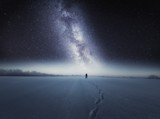 Starry night sky and man silhouette standing on snow - 233479006