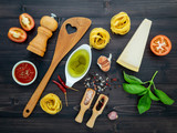 The  pasta on black wooden background. Yellow italian pasta with ingredients. Italian food and menu concept. - 233503868