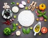 The ingredients for homemade pizza on dark stone background. - 233504009
