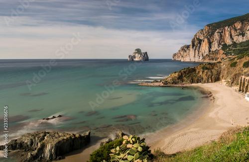 Foto Murales Suggestiva cornice scenografica dell'insenatura di Masua, con vista sull'Imponente roccia del Pan di Zucchero, lungo la costa dell'Iglesiente a sud ovest della Sardegna, Italia.