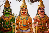 Indian hinduistic sculptures close to holy temple at the countryside of Tamil Nadu