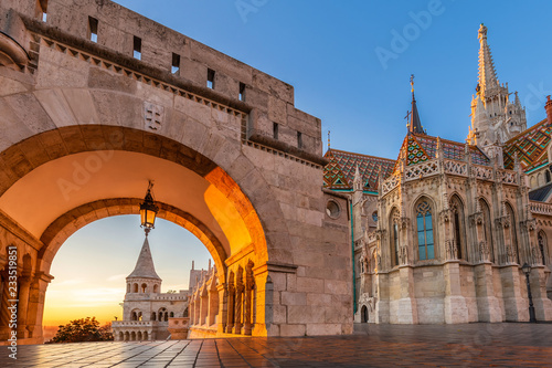 Budapest, Hungary - Entrance of Buda District with the beautiful Matthias Church at golden sunrise and clear blue sky