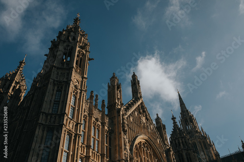 Westminster Palace. London, Uk. Old Palace Yard facade detail, with sun lighting and blue sky background.