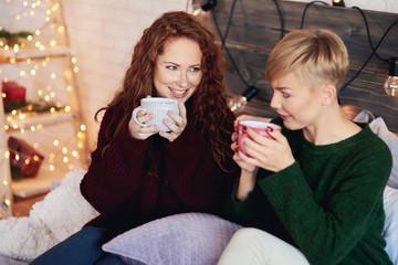 Happy girls drinking tea in bed