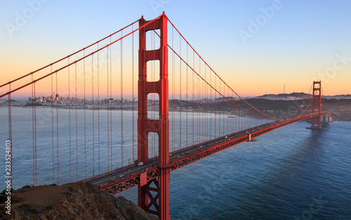 sunset over golden gate with san francisco city in background