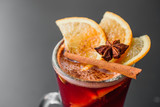 Mulled wine, with spices and fruits on dark background, isolated - 233531695