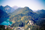View across the German Alps in Bavaria and the Hohenschwangau Castle in view - 233540238