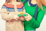 Happy mother and daughter exchanging Christmas gifts - 233541201