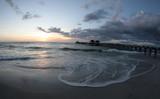 Beach scene at sunset - 233544691