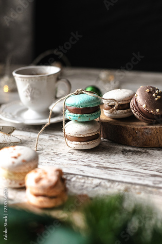 Wall mural cup of tea and christmas cookies macarons