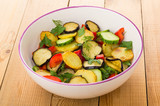 Fried potato, eggplant, cucumbers, sweet pepper and greens in bowl - 233564214