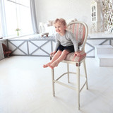 portrait of happy little girl sitting on a chair in the spacious - 233564657