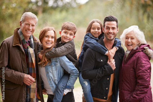 Leinwanddruck Bild Portrait Of Multi Generation Family On Autumn Walk In Countryside Together