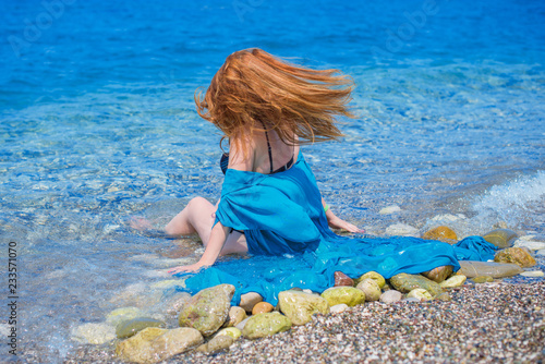 Foto Murales Woman rest and having fun at sea. Good mood on vacation, warm weather and happy tourist