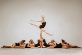 The group of modern ballet dancers dancing on gray studio background - 233573062