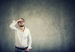 Leinwanddruck Bild - Pensive man looking up in problems