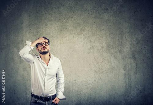 Leinwanddruck Bild Pensive man looking up in problems