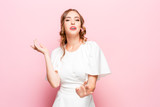 Happy business woman standing and smiling isolated on pink studio background. Beautiful female half-length portrait. Young emotional woman. The human emotions, facial expression concept - 233582253