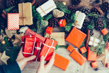 Top view of christmas gift box in woman hand. - 233588424