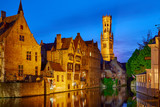 Bruges, Belgium. Evening sunset with blue sky. Water channels