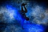 Man break dancing on dark