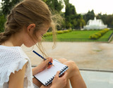 Young artist sketching fountain in national garden of Athens, Greece. - 233606886