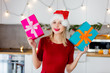 beautiful white girl with a gift boxes against the background of the scenery for Christmas in the kitchen