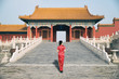 Asian young woman in old traditional Chinese dresses in the Forbidden city in Beijing, China.